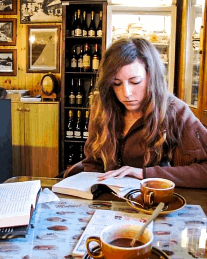 woman intentionally reading at coffee shop