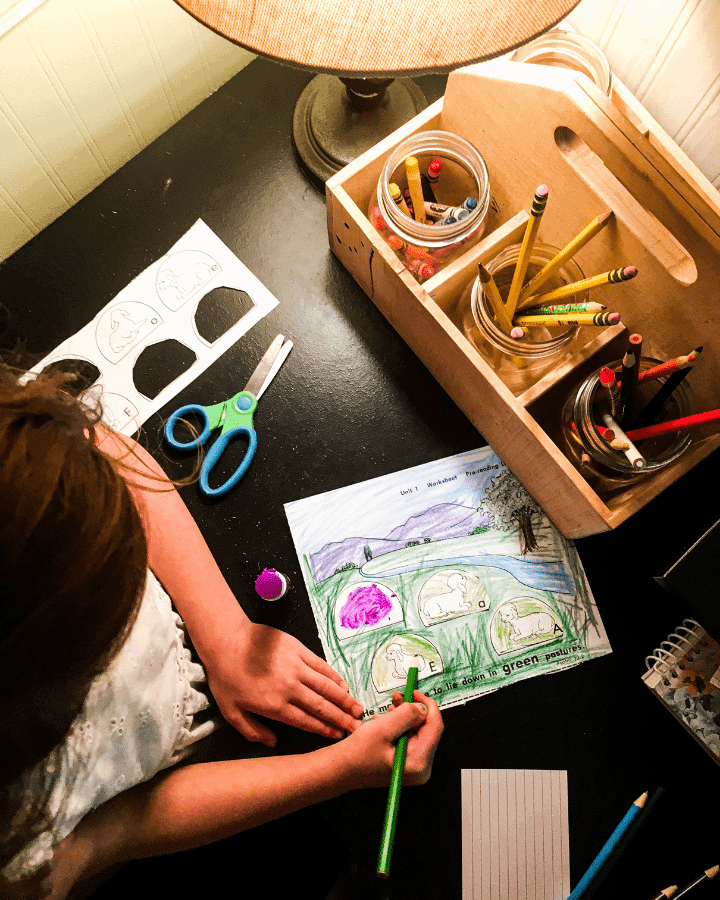 A girl making art in an educational atmosphere at home.