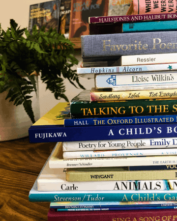 tall stack of children's poetry books