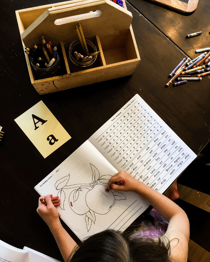 girl doing homeschool work at a table