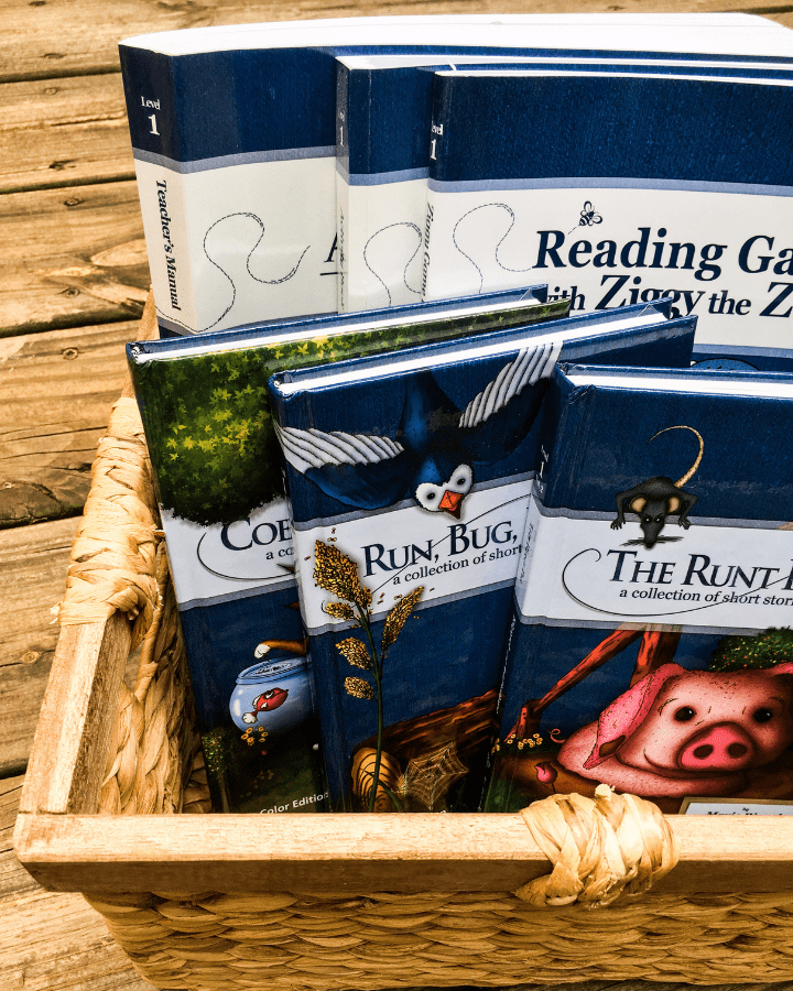 A bunch of books for All About Reading Level 1 in a basket.