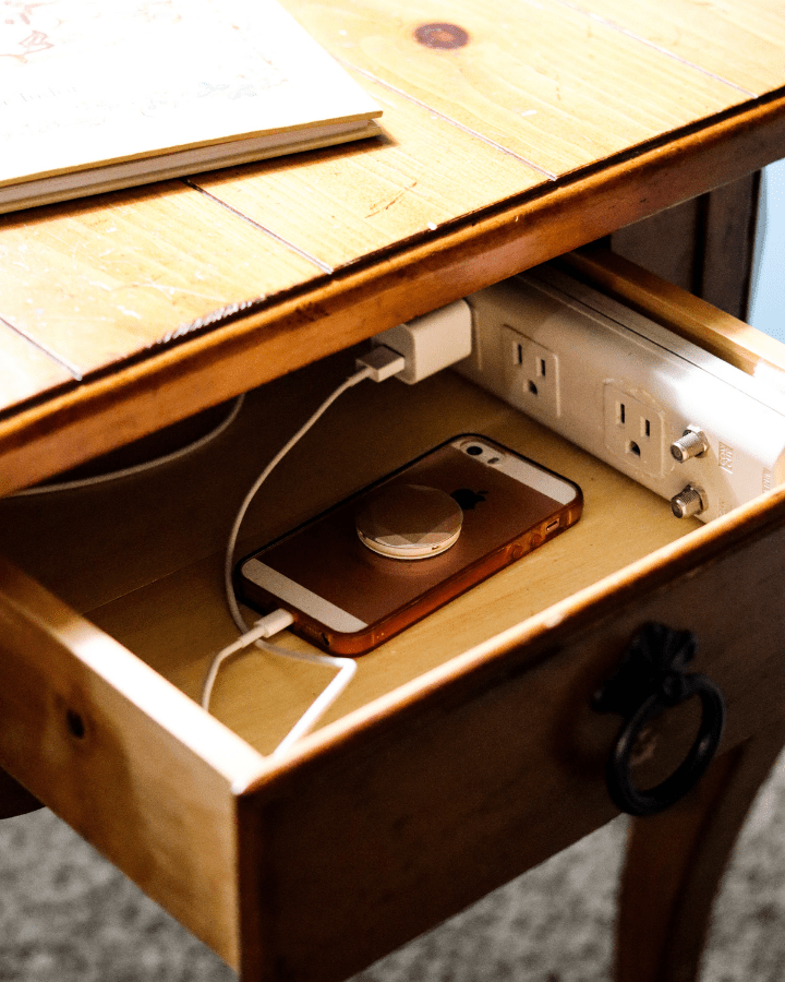 A phone inside a side table, making it easy to take a technology break.